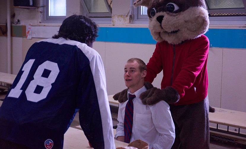 Brantwood mascot with two students