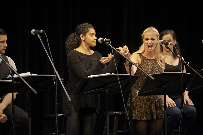 two female performers argue